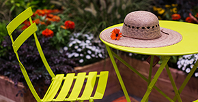 Patio chair and table with straw hat